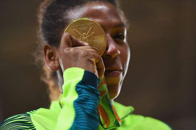 Girl from impoverished 'City of God'  claims first gold medal for host country Brazil