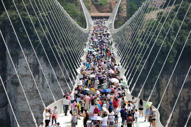 World's longest glass bridge in China attracts ten times daily capacity of 8000 visitors