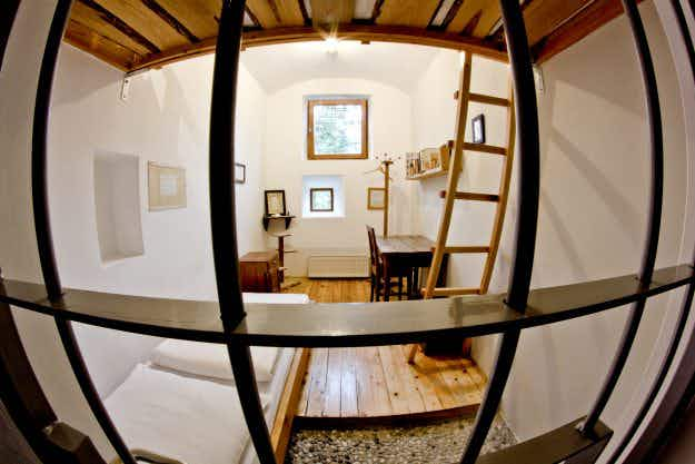 This former Slovenian prison is now a beautiful hostel with uniquely furnished cells