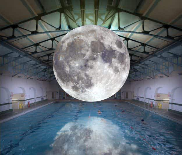 An exhibition featuring a photo-realistic inflated replica of the moon is travelling the world