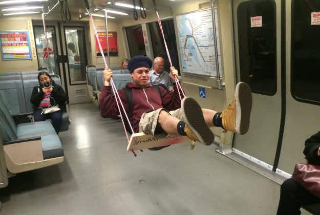 Artist installs swings on San Francisco's subway trains, making some commutes actually fun
