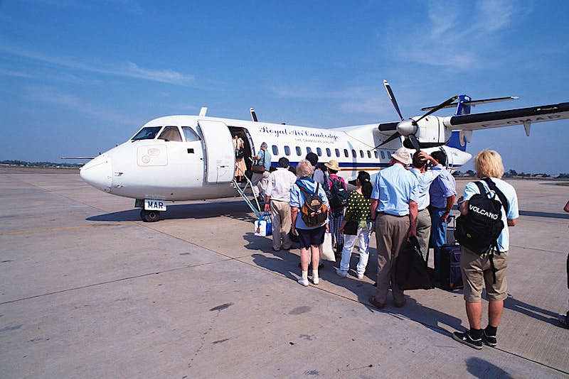 People standing in line to board a plane