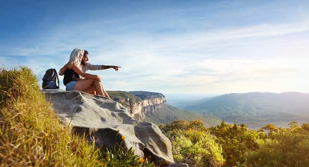 Australia's proposed 'backpacker tax' has been reduced in an effort to draw in more travellers