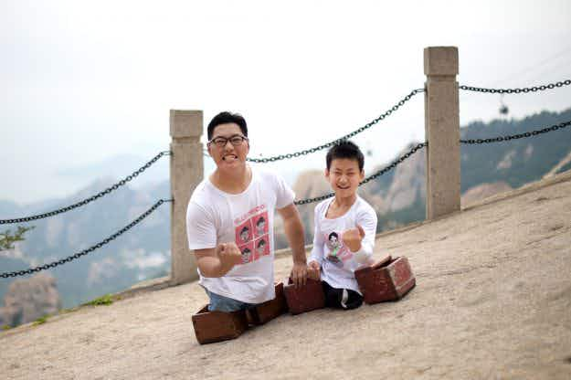Watch as an 11-year-old Chinese boy with no legs makes impressive climb up Mount Lao