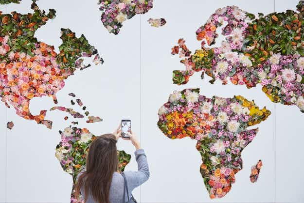See a gorgeous map of the world made entirely of flowers at London's Heathrow Airport