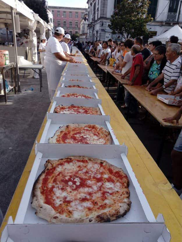 That's a big pizza pie record! Italian chefs bake over 5000 pizzas in 12 hours
