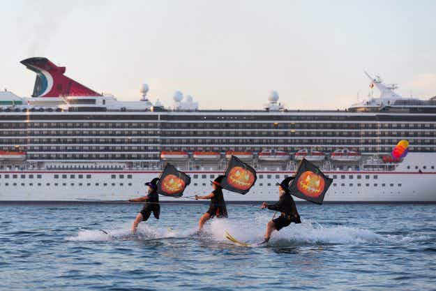 Water skiing witches welcome cruise ship into Sydney Harbour for Halloween