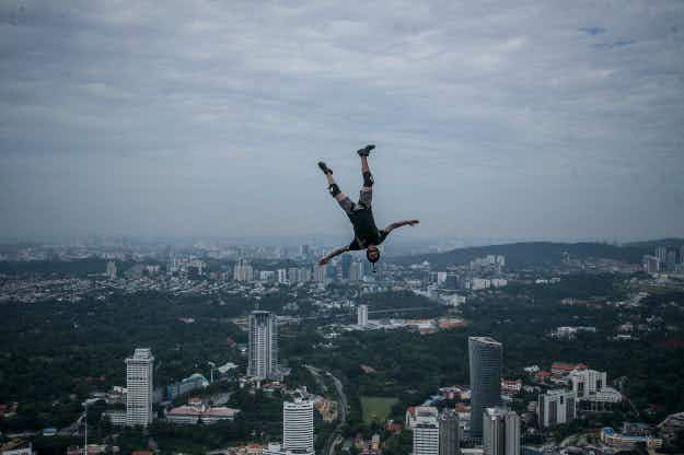 Don't look down! Over 100 base jumpers leap from the top of the Kuala Lumpur Tower