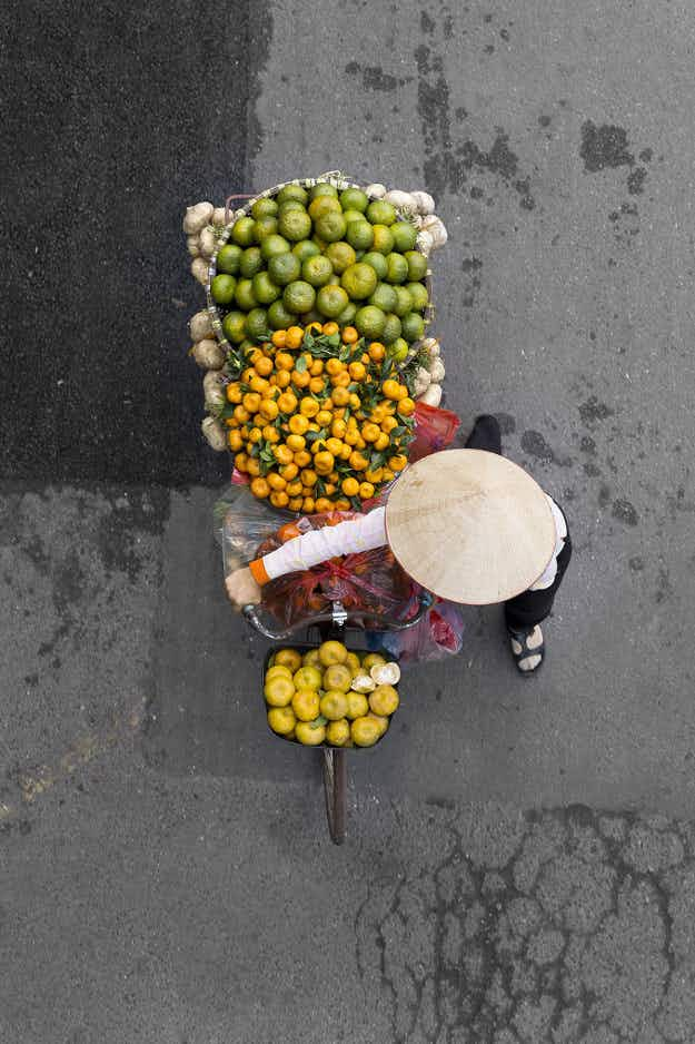 See beautiful images of Hanoi street vendors from above as they travel through the city