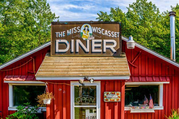 Photographer documents unique hand painted signs and symbols of Americana across Route 1