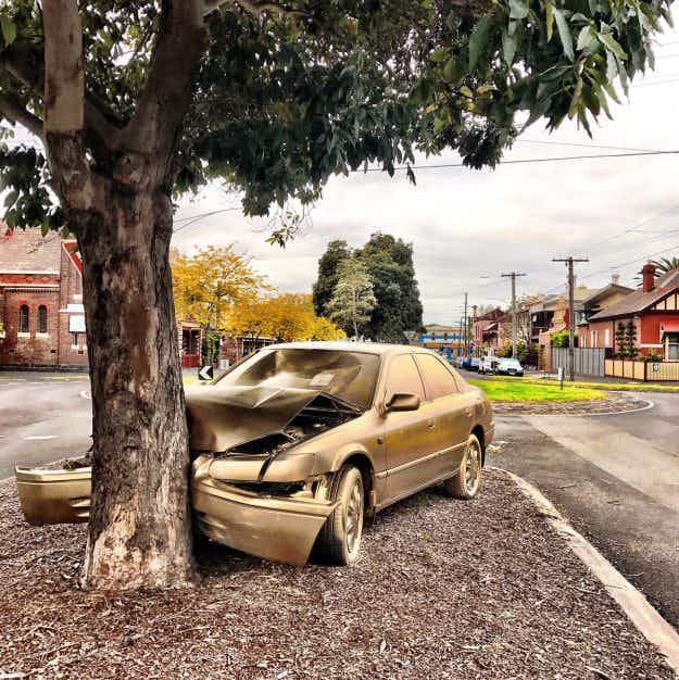 An abandoned car in Melbourne has been turned into a gold street art installation