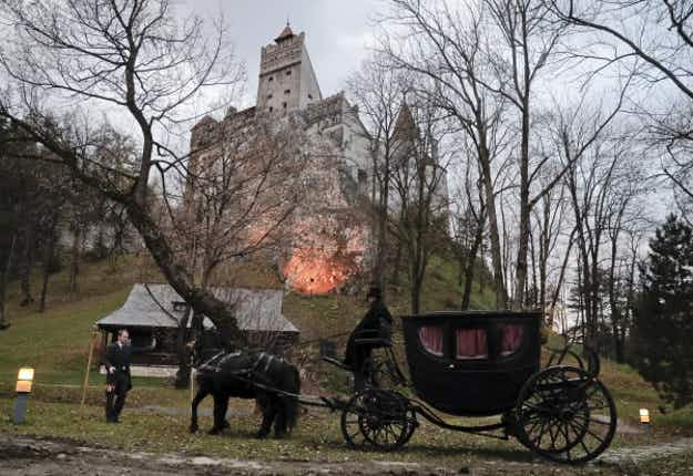 These fearless siblings spent Halloween curled up in a coffin at Dracula's castle in Transylvania