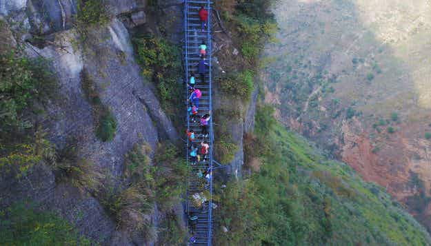 A steel ladder has created a safer path for cliff village children to go to school in China