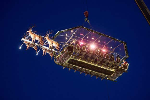 'Santa in the Sky' sees Belgian diners eating at a sleigh restaurant in the air