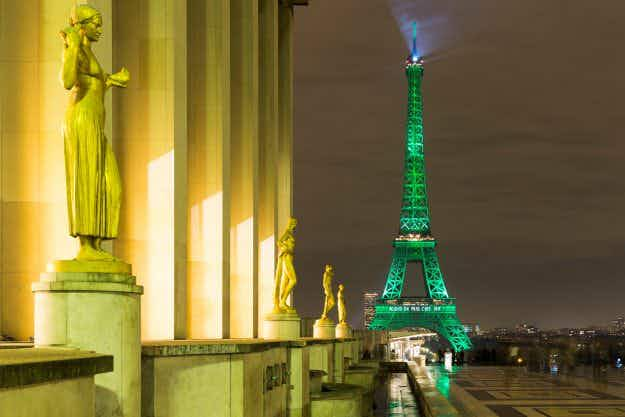 Paris monuments light up green to celebrate historic climate change action