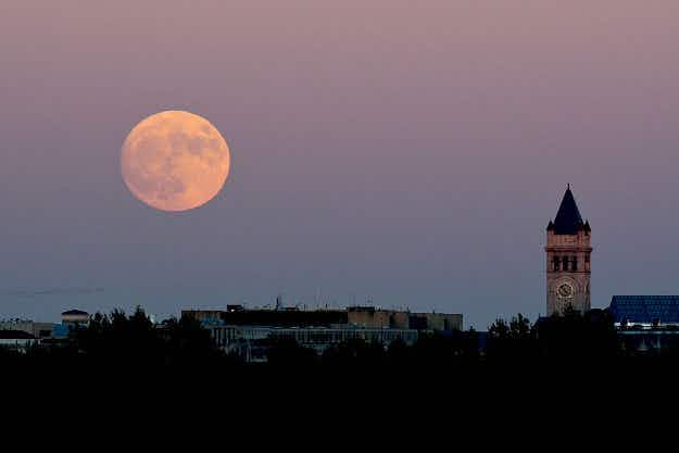 See a first glimpse of the super moon of the century as it lights up skies around the world