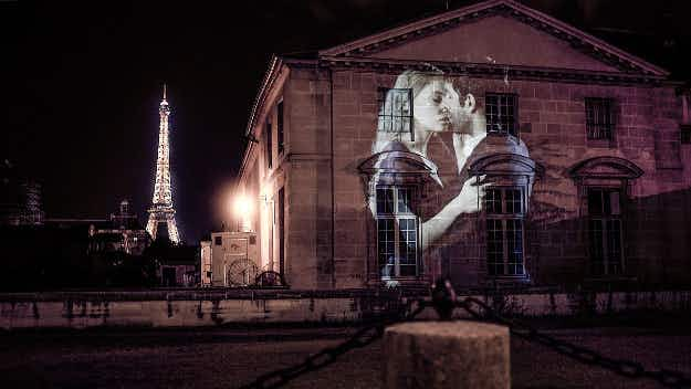 See Paris lit up with romantic projections of couples kissing around the City of Love