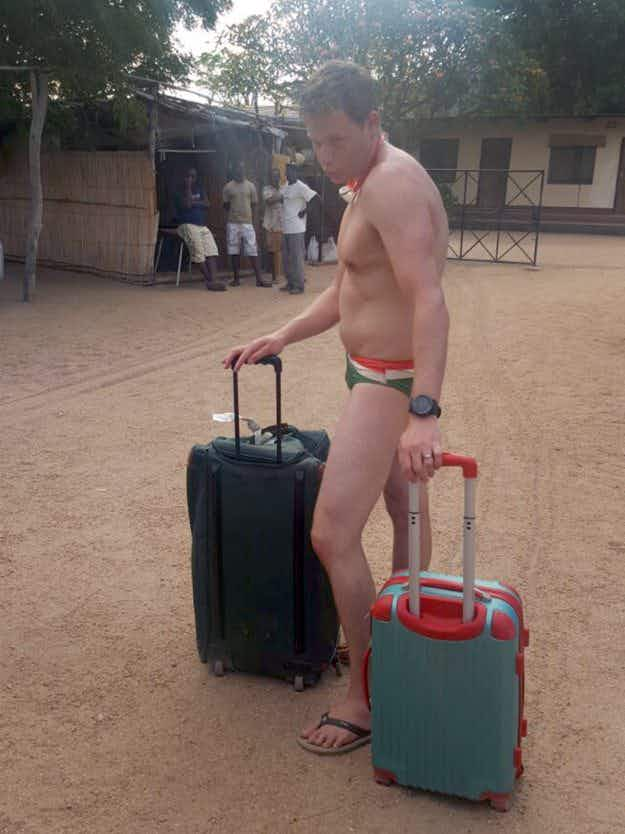 This man checked in for his flight at Malawi airport in nothing but Speedos and flip-flops