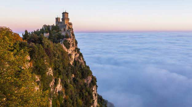 Stunning time-lapse video shows waves of thick fog washing over San Marino