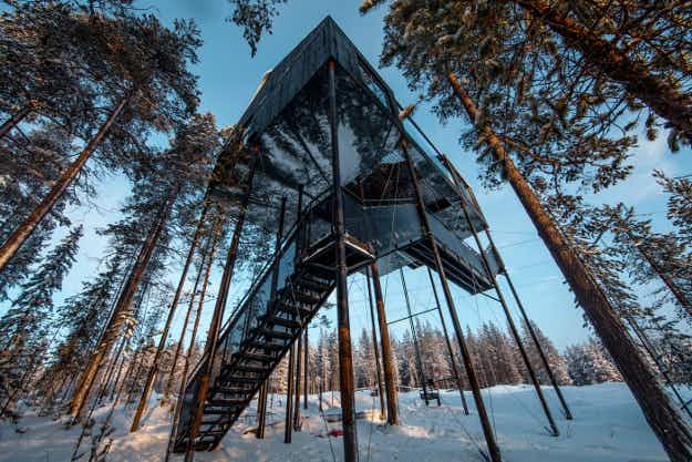 This new treehouse hotel room in northern Sweden has a net patio where guests can stargaze