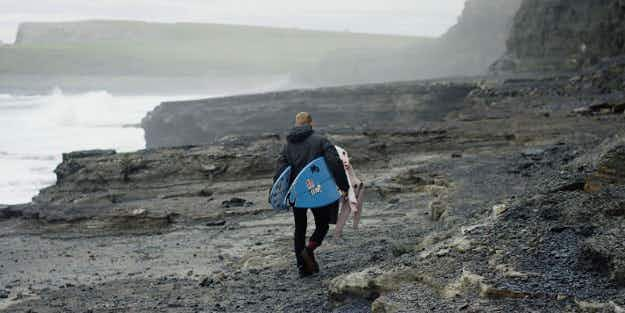 Watch as famous Aussie surfer Mick Fanning catches incredible waves off Irish coast