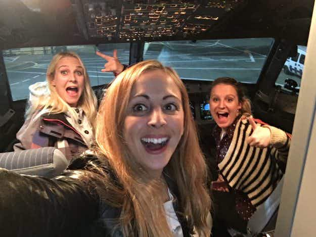 These three friends got an entire flight to themselves with business class upgrades, free champagne and food