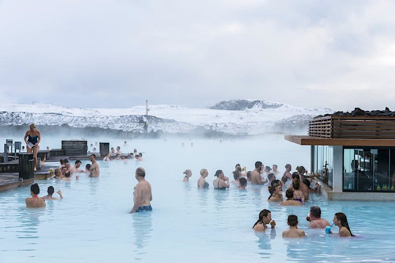 People bathing in a lake in Iceland