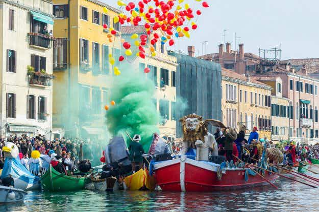 This year's stunning Venice Carnival launches with a colourful water parade
