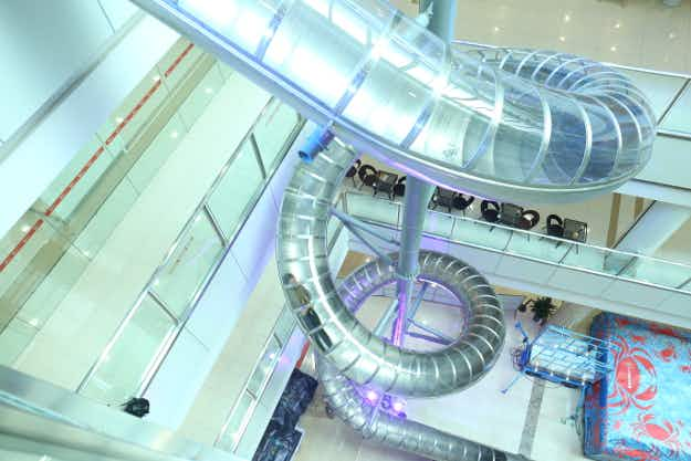 Shoppers can now zoom down a four-storey slide at a mall in China