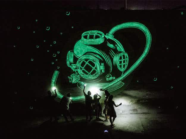 See the incredible murals in Europe that change as they glow in the dark