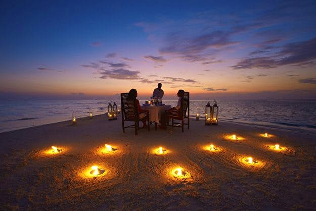 You can dine on a sand bank and watch an open air movie at this resort in the Maldives - Lonely Planet