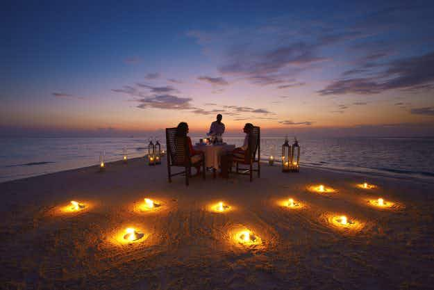 You can dine on a sand bank and watch an open air movie at this resort in the Maldives