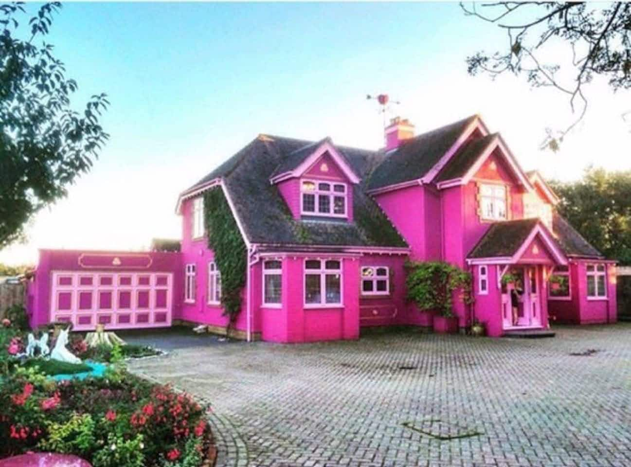 Visitors will be tickled pink by this fuschia-hued English Airbnb complete with garden unicorns