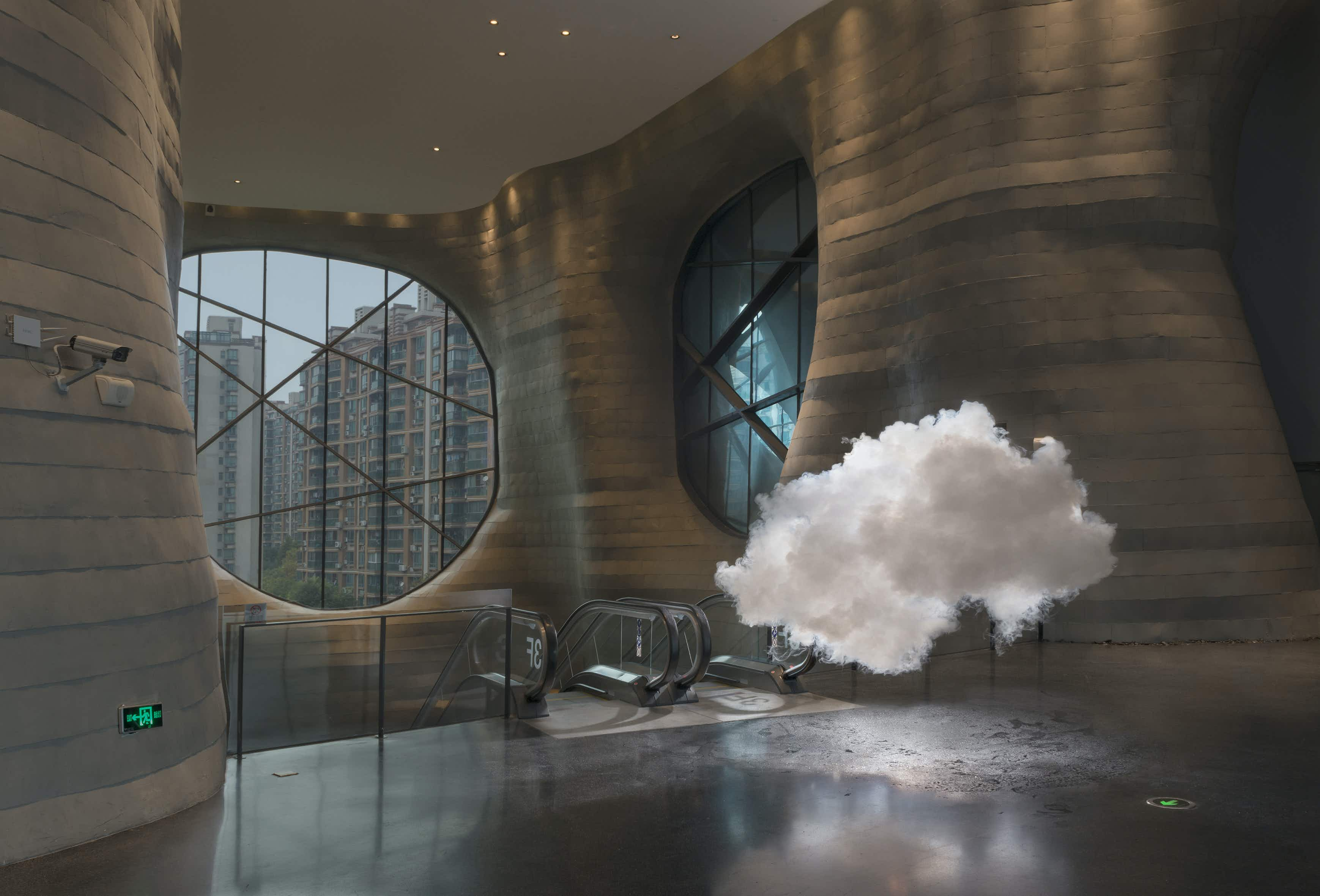 An artist creates miniature clouds in spaces around the world