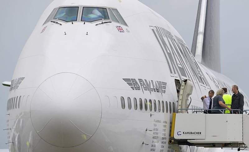 Vocalist and pilot Bruce Dickinson of the British group Iron Maiden stands at the gangway of the band's Boeing 747-400. Image: Tobias Schwartz/AFP/Getty Images