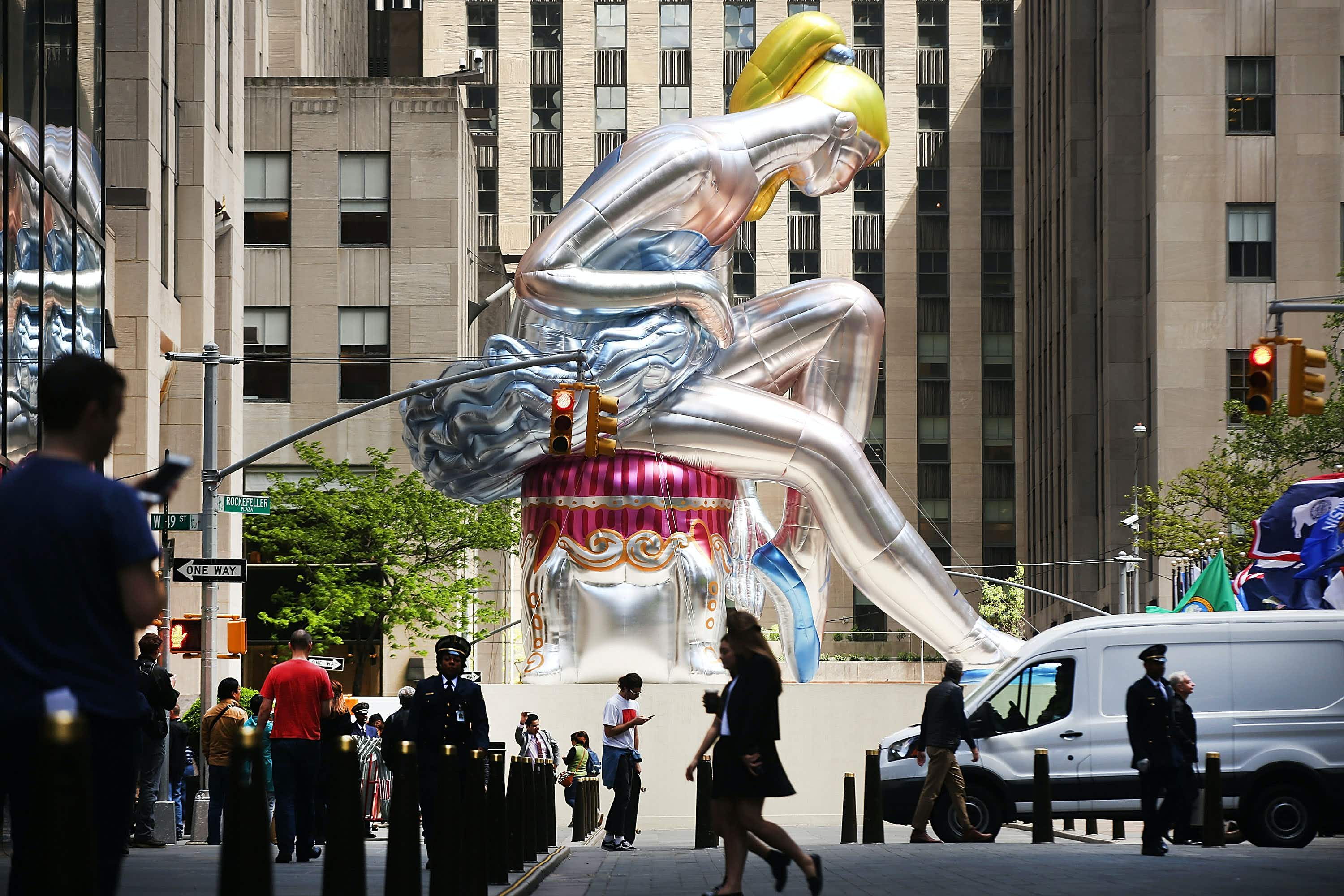 A giant 45-foot inflatable ballerina is on display at New York's Rockefeller Center