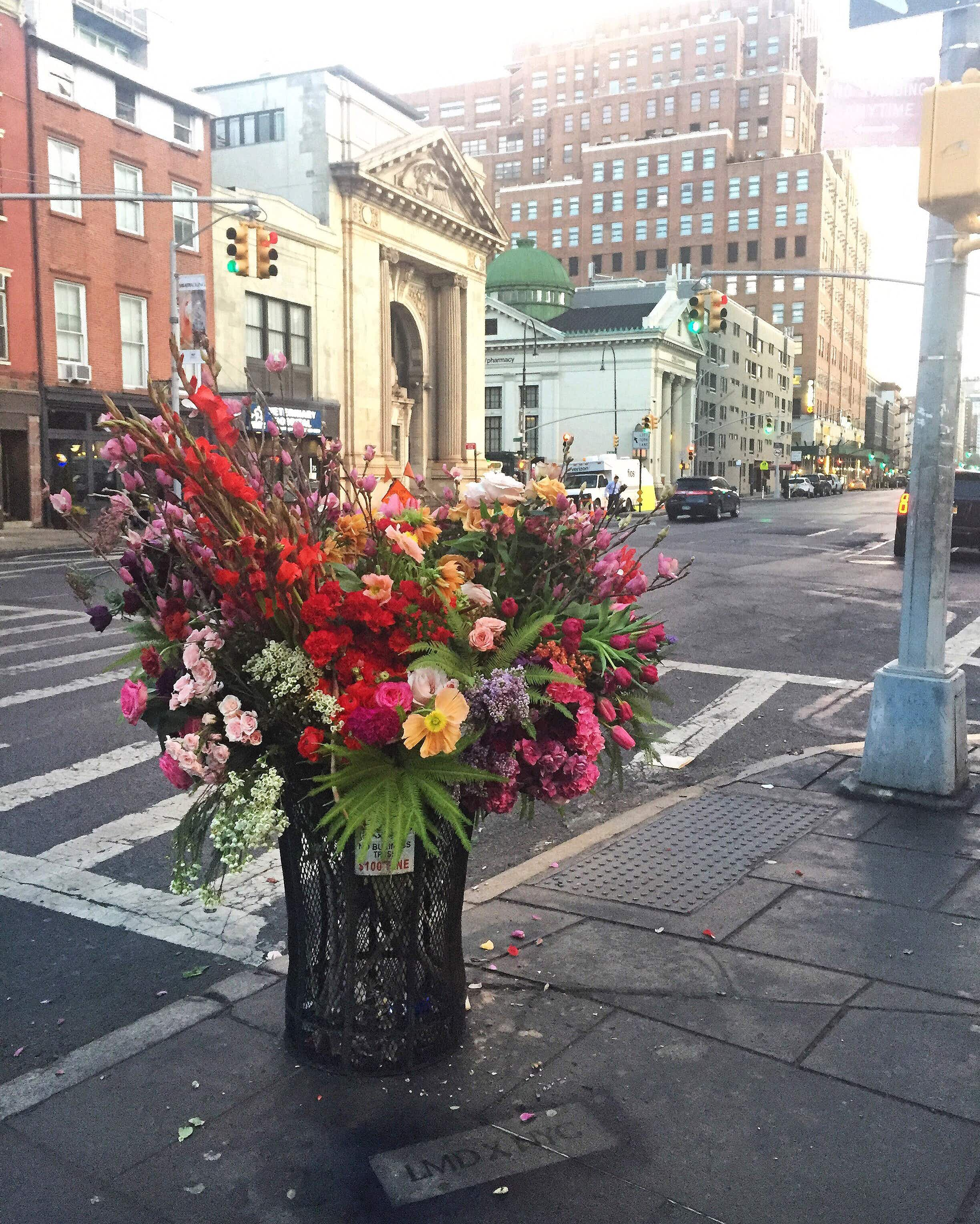 A floral designer is transforming trash cans around New York City