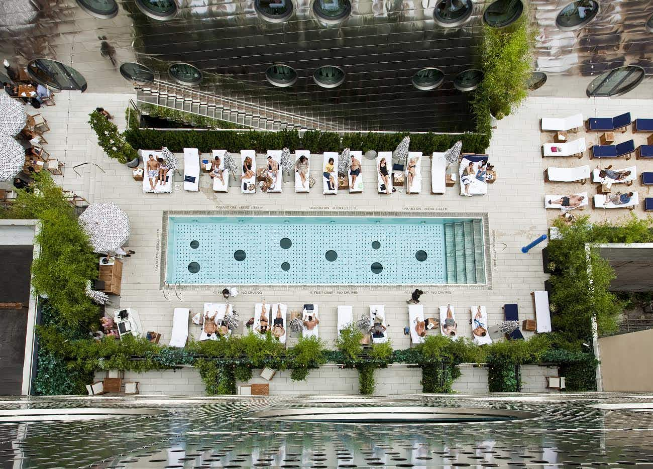 This New York rooftop pool imported sand from the Hamptons so you can stay in the city