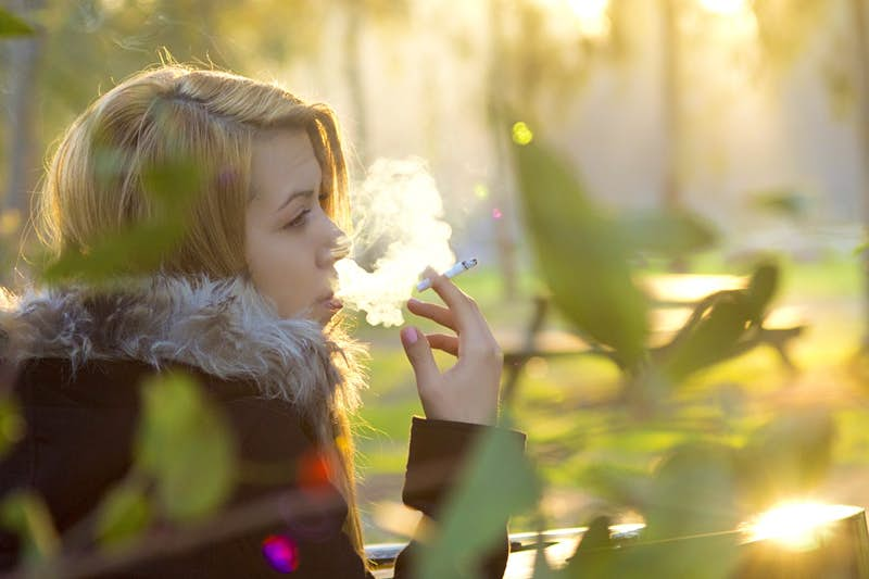 Travel News - smoking beautiful young woman