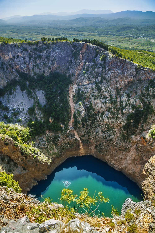 Watch daredevil slackliners walk 280 metres above spectacular Croatian lake