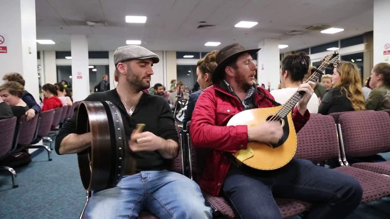 Watch: what do you do when your flight to Ireland is delayed? Have a traditional music session of course