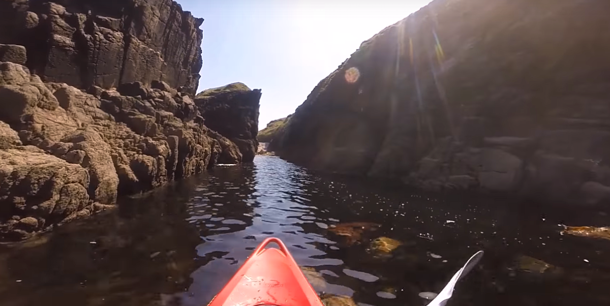 Take a break with this video of a kayaker going through a secret tunnel under an island off the coast of Ireland - Lonely Planet