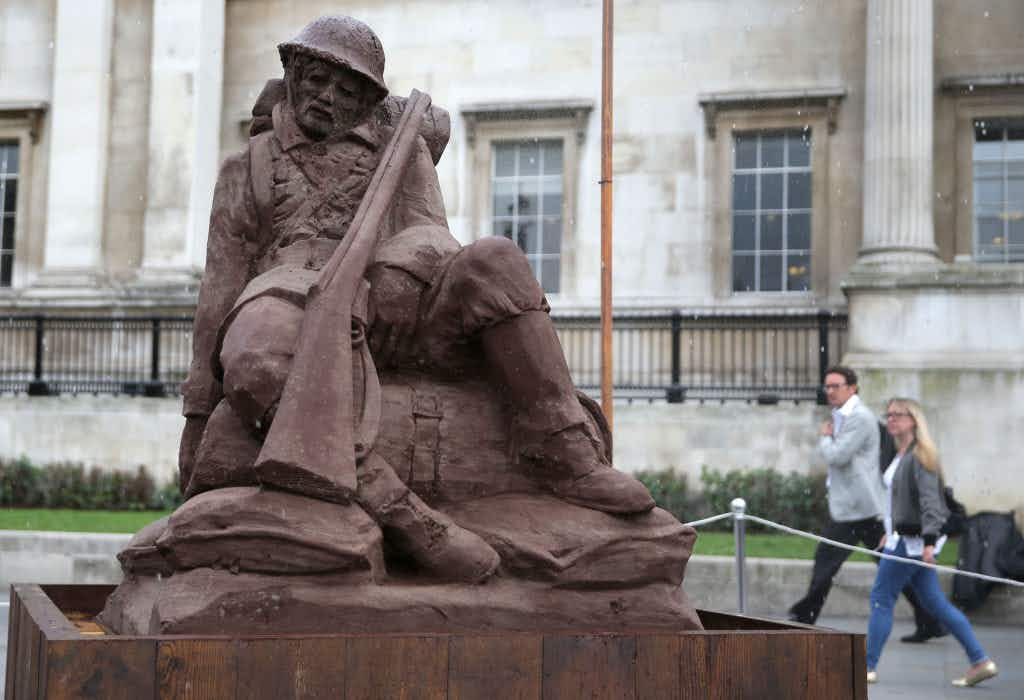 A sand and mud sculpture of a soldier built on Trafalgar Square will disappear over the next few days