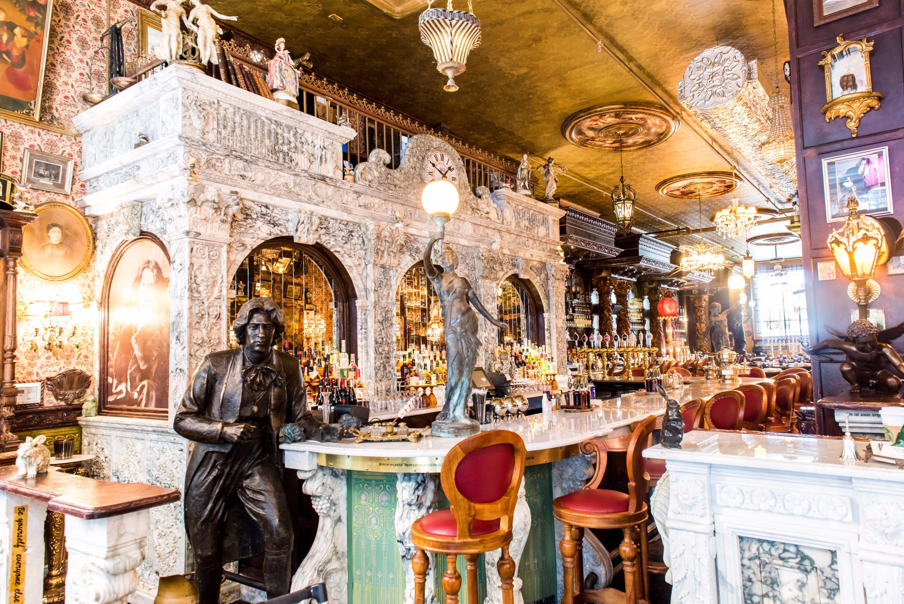 A glamorous Oscar Wilde-themed pub with the city's longest bar has opened in New York