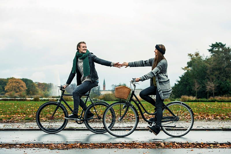 A couple cycle in Copenhagen