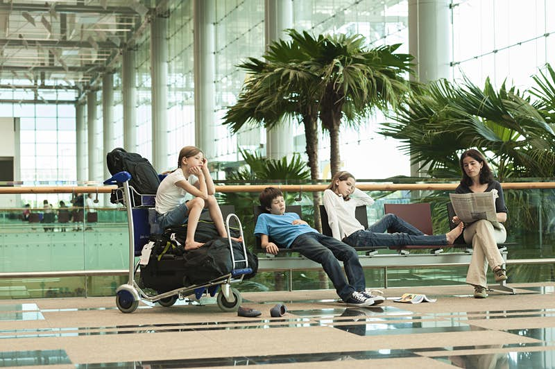 Travel News - Family waiting in airport terminal