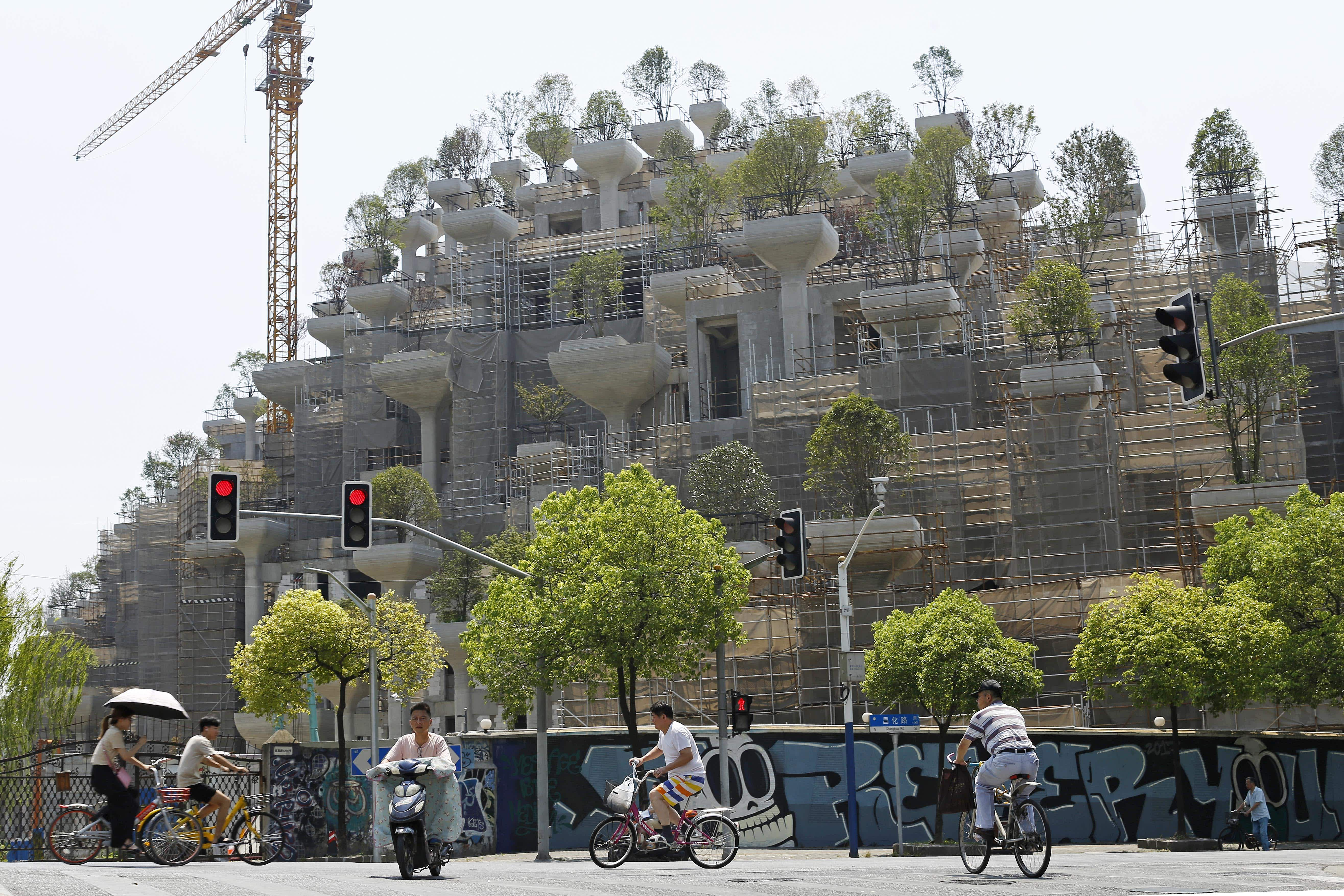 This amazing tree-covered building under construction in Shanghai is already attracting attention
