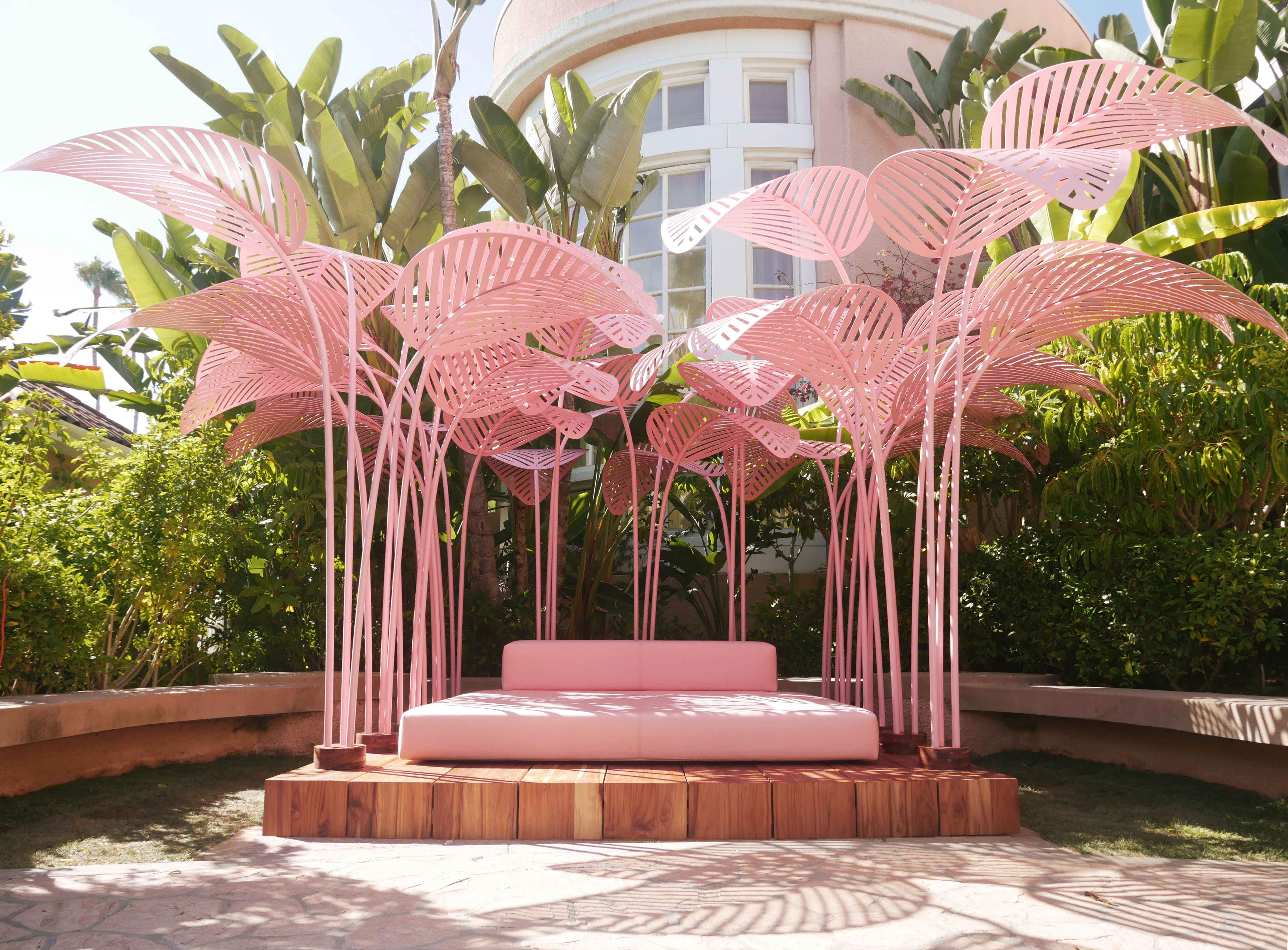 This gorgeous pink daybed is the ultimate relaxation stop at the Beverly Hills Hotel
