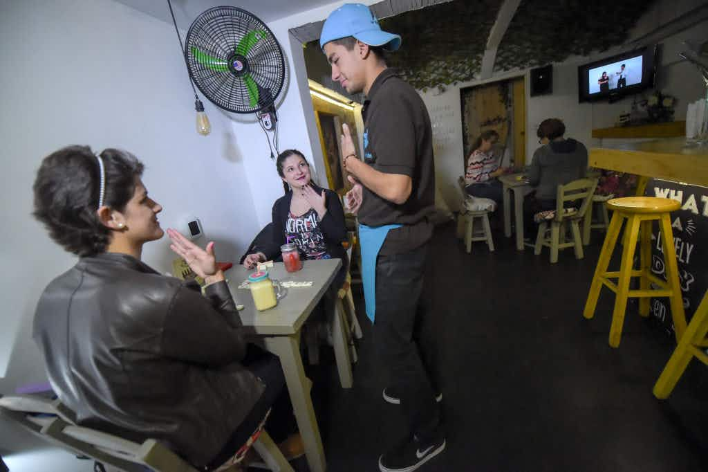 Bogotá's newest bar is designed for people with hearing impairments and is proving a huge success