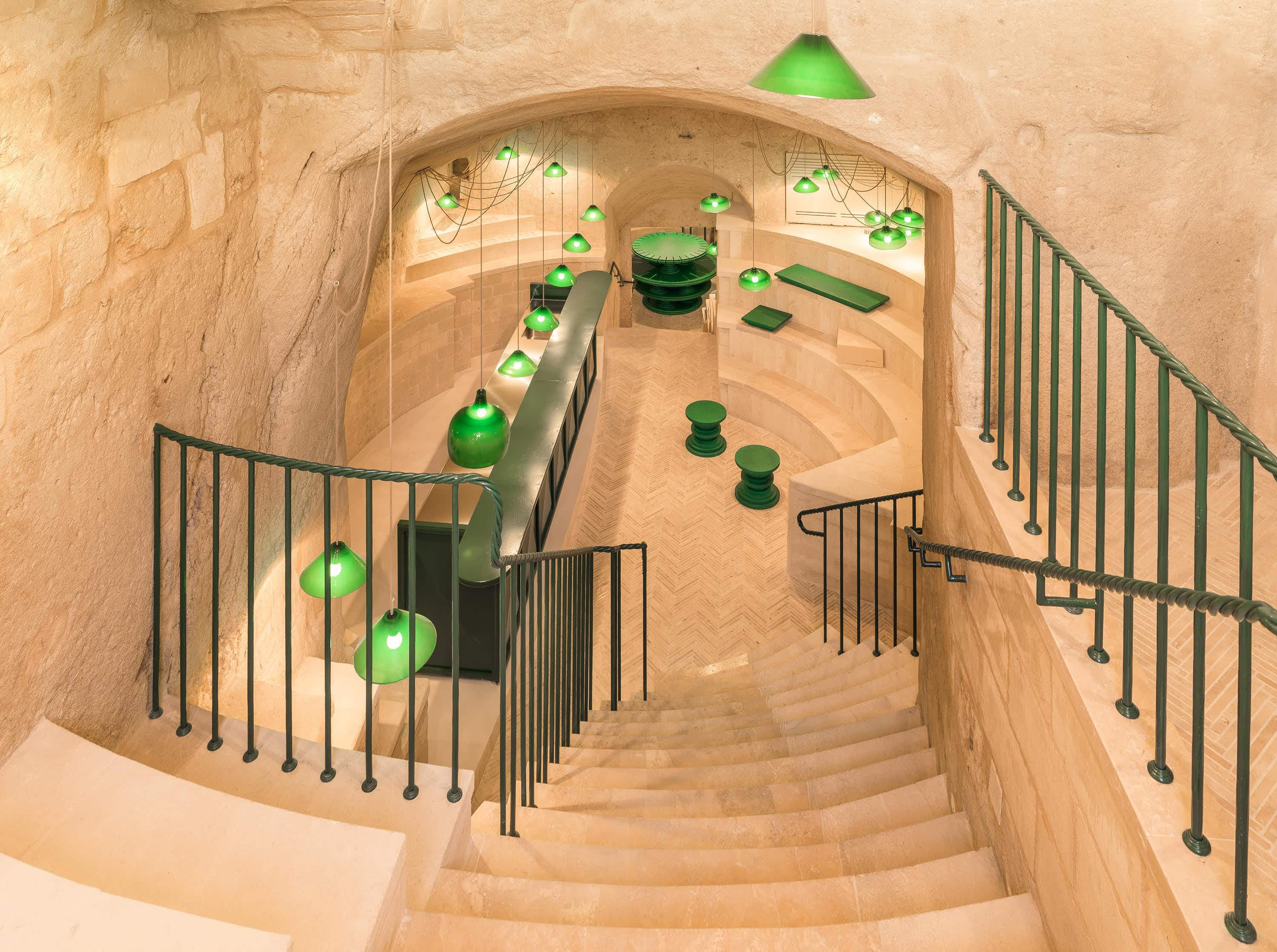 Sample wine in an historic cave beneath Matera's rocky hills in Southern Italy
